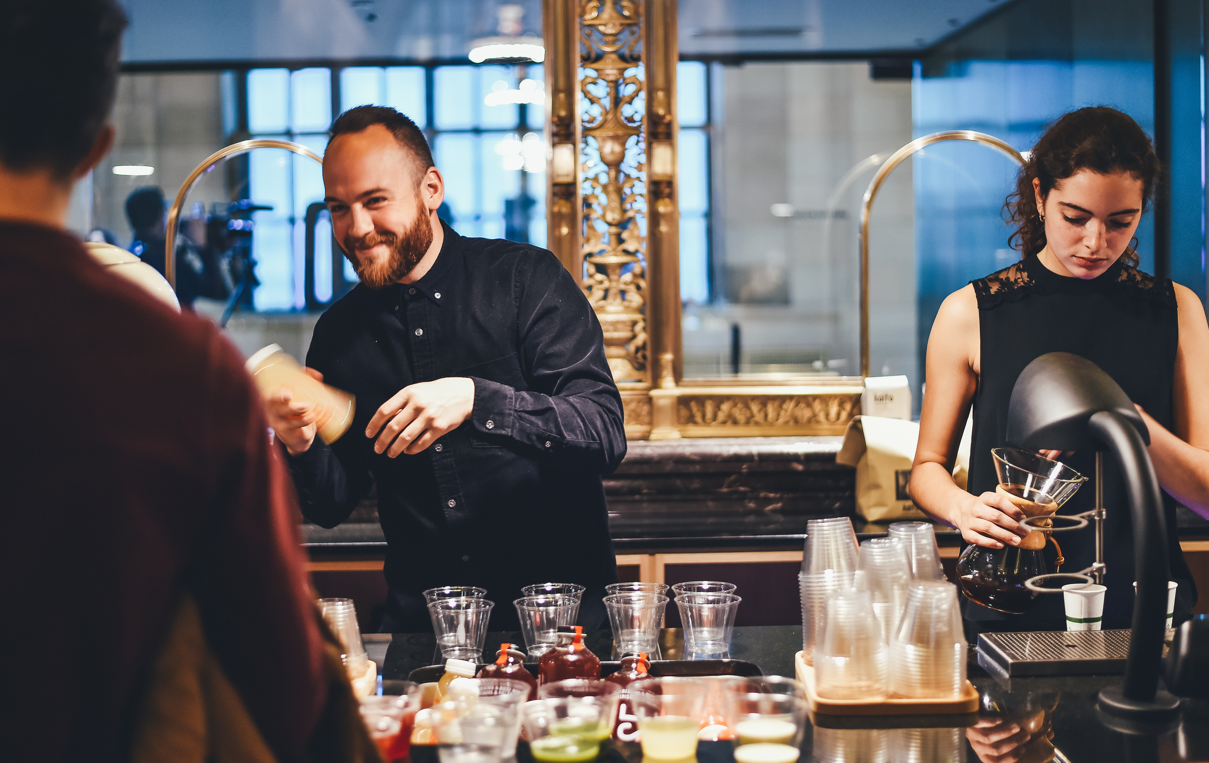 happy male and a female bartender