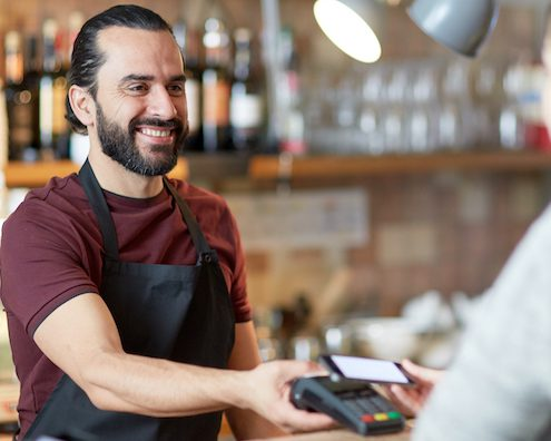 customer service - barman and woman with card reader and smartphone